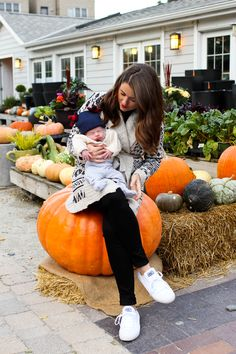baby and mom style for fall at the pumpkin patch