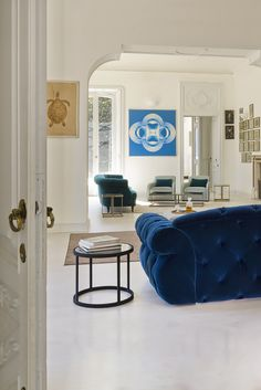 Fabulous in any setting, the Italian Diamond Quilted Blue Velvet Sofa. This voluptuous modern sofa is chic and stylish. Its shapely design offers superb comfort and style!