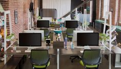 Do you want to work with fluorescent lighting and drab grey rooms or this nice open office? #openplanoffice Cubicles.com