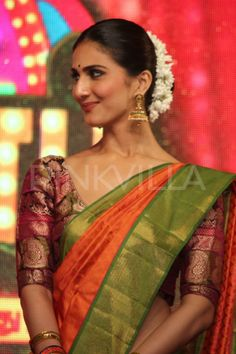 Pulled back hair and saree blouse with a decent wide neck minus the sleeves