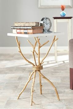 another idea for using real tree branches and making your own table with a scrap piece of marble, woood round, or granite