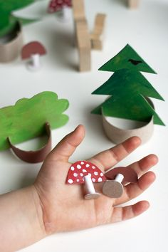 Make a Cardboard woods | Cut and paint old cereal boxes to be trees and use slices of toilet paper or paper towel rolls to make stands.