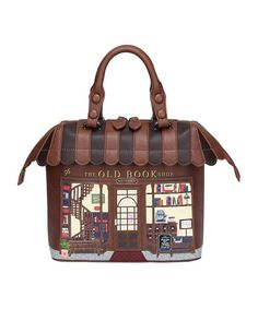 Step back in time and enjoy the charm of the old bookshop. This is a bag that oozes quality with its handmade touches and timeless shop front design. Its quirky and unique style is cute and colourful and offers an everyday bag that you will wa Vegan Leather, Pu Leather, Zip Puller, Unique Handbags, Lovely Shop, Shop Front Design, Old Books, Everyday Bag, Grab Bags