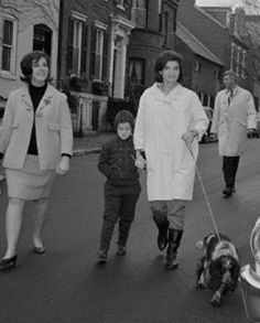 Just weeks after the assassination, the widowed First Lady walks Shannon in Georgetown near her new, temporary home with daughter Caroline and half-sister Janet, 1964.