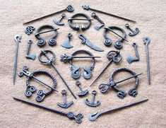 Steel brooches and pendants 2 by Astalo on deviantART