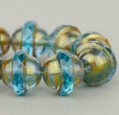 Saturn Beads - Saucer Beads - Czech Glass Beads - Aqua Blue Transparent with Antiqued Bronze Finish - 10x12mm Beads - 5 or 10 Beads @SolanaKaiBeads on Etsy #SolanaKaiBeads #SaturnBeads #Beads #BeadShop