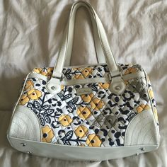 Vera Bradley purse Vera Bradley purse. No rips or stains just small marks on bottom from use and same with straps slightly dirty. Sure it could all be cleaned just never tried. 13 inches wide 10 inches Tall.Offers are always welcome Vera Bradley Bags Totes