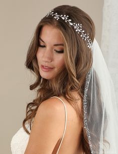 Weave a garland of wired opal crystals and clear rhinestones into your wedding day hairstyle for a light touch of elegant beauty. You'll feel naturally gorgeous wearing this delicate, sparkling hair vine. Pair it with an embellished veil to finish off your look. This piece is from Bel Aire Bridal style #6628 and we have …