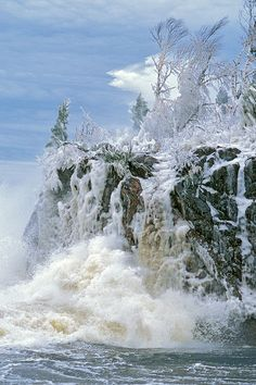 Tettegouche State Park, North Shore, Lake Superior Winter Fantasy Gale-force winds and sub-freezing temperatures create an otherworldly scene at the outlet of the Baptism River into Lake Superior. As the massive waves crashed against the shoreline cliffs the water instantly froze, coating this rock outcropping (and photographer!) in a shell of ice. The wave rising behind the trees at the top of the cliff is more than 30 feet high.