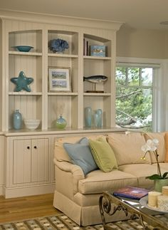 Beautiful display, color-themed, and using large items to fill the nooks.  Lovely room overall.