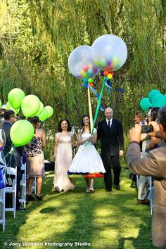 The bride carried giant clear balloons filled with smaller colorful balloons!