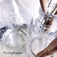 Little details....a favorite wine bottle goes utilitarian in the kitchen.  Dishes may be necessary, but they don't have to be boring.  #fleaingfrance #decor #kitchen #brocante #myhome #french
