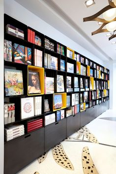 Taschen& first store in Italy opens in Milan: Marc Newson's custom bookshelves on the ground floor are crafted from welded, double-polished, coated, and varnished steel modules with yellow Corian inlays. Bookstore Design, Library Design, Retail Interior, Best Interior, Deco Cafe, Module Design, Custom Bookshelves, Store Interiors, Office Interiors