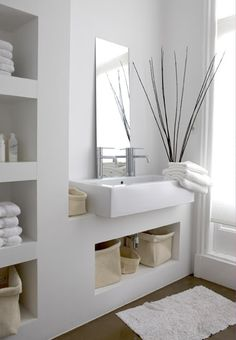 contempory white storage built in Méchant Design: saturday life style: Paula's house