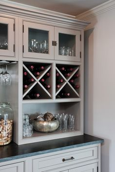 Home Bar Featuring Custom Cross Wine Storage And Under Cabinet Stemware Holders