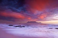 AUTUMN STORM IN TABLE BAY Blouberg Beach, Cape Town, Western Cape, South Africa Curtains of ghost rain hang from a storm cloud passing over the Peninsula on a warm May evening as the waves wash over the iconic Blouberg beach. This was probably the first and last time I will such a sunset over Table Bay as Cape Town rarely gets the type of thunder shower systems that form these clouds. Photo by Hougaard Malan.