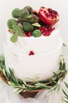 fig and pomegranate topped wedding cake