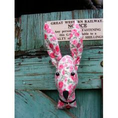 Fake taxidermy , shabby chic, pink blown roses country house, Rabbiut, Hare,  trophy head.