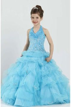 Hannah and I love the skirt on this dress.  We would change the color to purple or gold and change the halter top to something more modest.