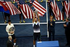 PHOTOS: Cilic holding up the US Open tennis trophy after defeating Japan's Kei Nishikori. It was the first Grand Slam final for both players and for Nishikori he was the first Asian male player to reach a final of a Grand Slam
