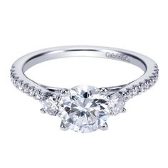 14k white gold 1.45cttw 3-stone plus prong set diamond engagement ring with .45cttw of G/SI prong set side diamonds. Wonderfully proportioned and with classic details, this 3-stone plus mounting highl