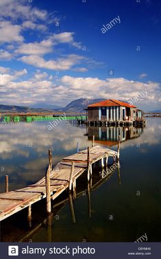 "Stock Photo - A traditional stilt house of the lakes (called ""pelada"" in Greek) in the lagoon of Messolonghi, central Greece Stilt House, House On Stilts, Lakes, Travel Destinations, Greece, Landscapes, Houses, Cabin, Stock Photos"