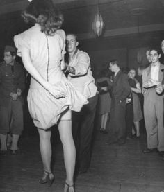 An aircraft worker swing dancing with his date at the Lockheed Swing Shift Dance (1942).