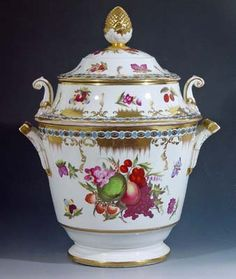 A Coalport Porcelain Botanical Fruit Cooler & Cover, Circa 1820. The Coalport fruit cooler with cover is finely painted with fruit, flowers and buttlerflies on each side in the Chelsea style.