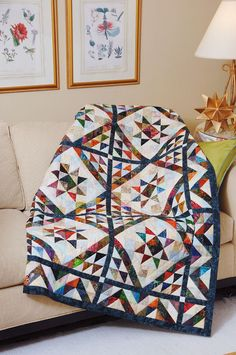 SCRAPPY TRIANGLES by Jean Nolte: This fun scrappy batik quilt pattern started out as a triangle-square exchange with a dozen friends. A dark blue batik for the sashing, borders and binding tie it together. Try this one to use up all those batik scraps you can't bear to toss out!  If you love scrap quilts or just want to work on a quilting project that's a little bit more challenging, then this quilt is for you!