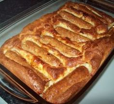 Toad in the Hole - 70g Plain Flour (sifted), 100ml Milk, 2 Medium Eggs (whisk all these together), 6 Sausages, Oil for cooking, Oven at 200C put Sausages in the oil, bake for 15 mins, pour over batter and return to oven for another 30 mins, serve with brocolli.