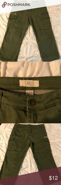 Army green colored cargo shorts These cargo shorts were really never worn and have been folded in a drawer. In very good condition and have pockets on the side in the front. cargo Shorts Cargos