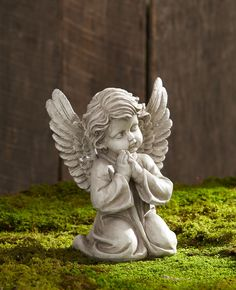 This is a really cute cherub and the price was Perfect. Description from kmart.com. I searched for this on bing.com/images