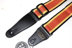 """Embroidered cloth guitar strap 2"""" wide Red Yellow Black for acoustic electric and bass guitarsNew P&P Embroidered cloth strap is 2 inches wide and very comfortable.  Red  and yellow stitching is put on black  cloth strap-its lightweight and a good soft feel on your shoulder and neck!"""