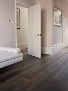 Lovely soft pink walls give a feminine touch to the textured rustic timber floor.