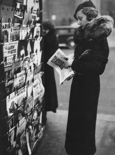 Miss Paris 1934 Elisabeth Argal,browsing a newsstand on the morning after her triumph. Photo: Anonymous