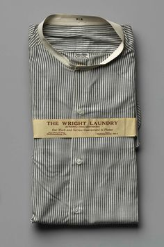 Man's shirt, cotton with mother-of-pearl buttons and wooden shirt stud, c. 1900, American.