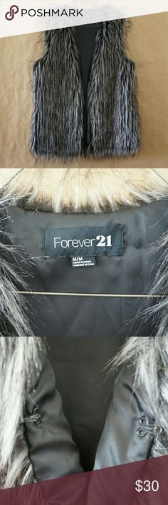 Forever 21 Faux Fur Vest Brown and cream/white. Excellent, like-new condition. Has a one hook closure halfway down the front of the vest to keep closed. Faux fur is super, super soft and fluffy. Forever 21 Jackets & Coats Vests