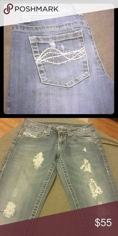 Cowgirl Tuff Ain't My Day To Care 27x33. Light wash jeans with rips in the front of the legs. cowgirl Tuff  Jeans Boot Cut