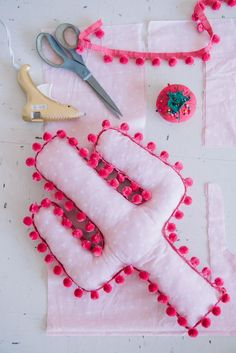 DIY Pom Pom Cactus Pillow, DIY and Crafts, When I was little, I was obsessed with sewing things by hand. My dad and aunt LOVED to go golfing, and one of my proudest childhood creations was maki. Diy And Crafts Sewing, Baby Crafts, Crafts To Sell, Sewing Pillows, Diy Pillows, Throw Pillows, Decorative Pillows, Cushions, Crafts For Teens