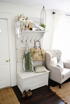 DIY hall tree - Made from an old door. painted the hall tree in Maison Blanche lime paint in white pepper [new favorite color!] & when it was dry I went over it with Maison Blanche white wax to seal it & give it more of an aged look. The shelf corbels I got from Home Depot, the hooks are from World Market & I actually waxed those as well.