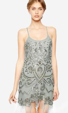 Made from a breathable woven fabric. Deep scoop neckline. Bead and sequin embellishment throughout. ...