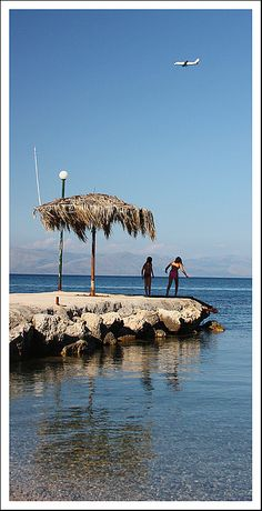 This is typical scene with de landing jets for de south east coast of Corfu, Benitses, Kerkyra, Ionian Islands_ Greece