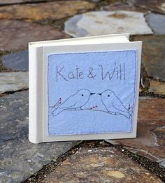 Preserve the memories from one of the best days of your life in this handcrafted wedding photo album. Hand-dyed wool-felt adorns the front of the album with stitched up love birds. Customize it with your initials for a good ol' trip down memory lane.