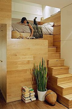A contemporary staircase leads to this cozy book nook just for one!