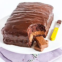 Tim Tam Cake. Chocolate Sponge Cake:   4 large eggs 110 g (1/2 cup) caster sugar 65 g cornflour (cornstarch) 35 g (1/4 cup) cocoa powder 1 Tbsp plain flour 1 tsp cream of tartar 1/2 tsp bicarbonate of soda 50 g unsalted butter, melted and cooled  Cake Filling:   100 g butter, removed from the fridge 30 minutes before starting 150 g chocolate, melted (semi-sweet or milk - up to you) 3 cups icing sugar, sifted 1 Tbsp milk Optional: 1 packet of Tim Tam biscuits, crushed or whole (your choice).