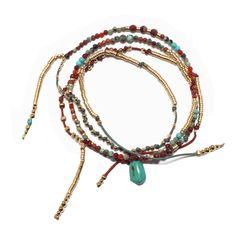 A gold-plated, handmade bead bracelet strung with variations of semi-precious stones.