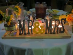 My yellow & gray DIY sweetheart table centerpiece for my couple. The sunflowers added the perfect touch to this summer wedding