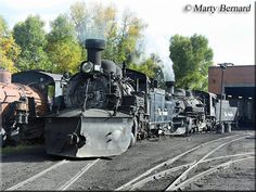 Rio Grande Class K-36 #487 and sister #488 steam up as they ready for another day of excursion service next to the shop in Chama, New Mexico on September 18, 2009.