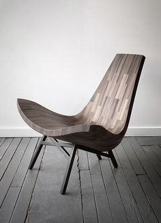 A low lying lounge chair made from reclaimed timbers of a New York City Water Tower