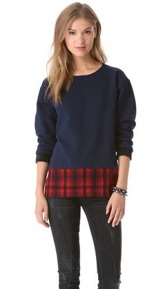 Sew a band of tartan fabric along the bottom of a sweater or sweatshirt to get this look.  Harvey Faircloth Terry & Plaid Tunic